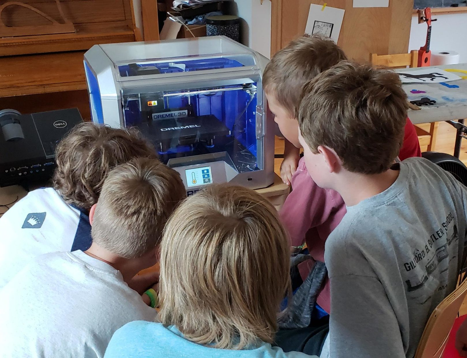 Dremel 3D printer with young learners